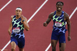 Winner, Michael Norman, left, and Michael Cherry, second, race in the men's 400-meter run at the U.S. Olympic Track and Field Trials Sunday, June 20, 2021, in Eugene, Ore. (AP Photo/Chris Carlson)