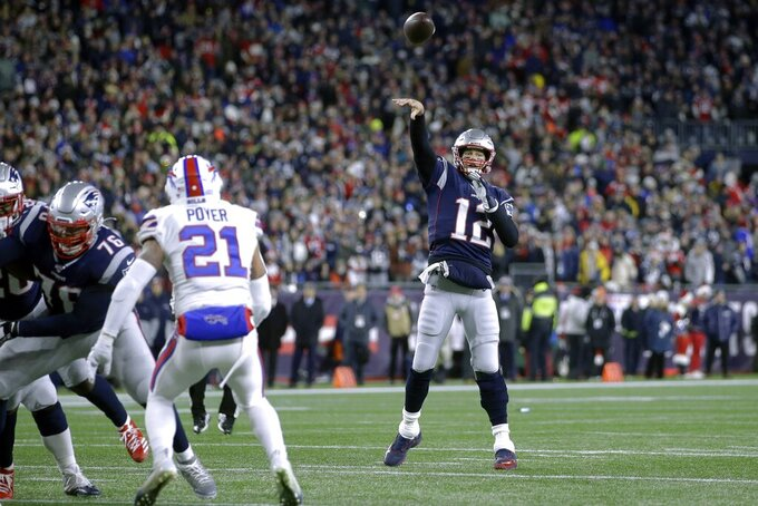 New England Patriots quarterback Tom Brady throws a touchdown pass to tight end Matt LaCosse in the first half of an NFL football game against the Buffalo Bills, Saturday, Dec. 21, 2019, in Foxborough, Mass. The touchdown pass Brady's 539th of his career, tying Peyton Manning for second all-time most touchdown passes by an NFL quarterback. (AP Photo/Steven Senne)
