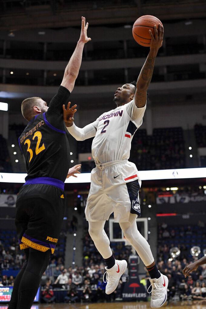 Connecticut's Tarin Smith (2) shoots over East Carolina's Dimitrije Spasojevic (32) during the second half of an NCAA college basketball game, Sunday, Feb. 3, 2019, in Hartford, Conn. (AP Photo/Jessica Hill)