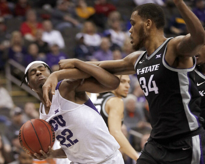 TCU guard RJ Nembhard (22) is fouled by Kansas State forward Levi Stockard III (34) during the second half of an NCAA college basketball game in the first round of the Big 12 men's tournament in Kansas City, Mo., Wednesday, March 11, 2020. Kansas State won 53-49. (AP Photo/Orlin Wagner)