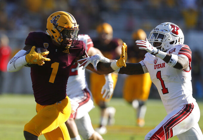 FILE - In this Saturday, Nov. 3, 2018, file photo, Arizona State wide receiver N'Keal Harry (1) fends off Utah defensive back Jaylon Johnson in the second half of an NCAA college football game in Tempe, Ariz. Harry broke out with his best game of the season last week in a huge victory for the Sun Devils against Utah. (AP Photo/Rick Scuteri, File)