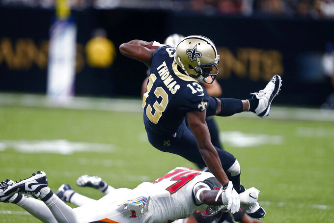 New Orleans Saints wide receiver Michael Thomas (13) is upended by Tampa Bay Buccaneers safety Mike Edwards in the first half of an NFL football game in New Orleans, Sunday, Oct. 6, 2019. (AP Photo/Butch Dill)