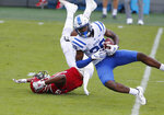 Duke cornerback Jeremiah Lewis (39) intercepts a pass intended for North Carolina State wide receiver C.J. Riley (19) during the first half of an NCAA college football game at Carter-Finley Stadium in Raleigh, N.C., Saturday, Oct. 17, 2020. (Ethan Hyman/The News & Observer via AP)