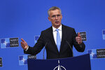 NATO's Secretary General Jens Stoltenberg talks to journalists during a press conference at the second day of a NATO defense ministers meeting at NATO headquarters in Brussels, Thursday, Feb. 14, 2019. NATO defense ministers are discussing the future of the alliance's operation in Afghanistan and how best to use its military presence to support political talks aimed at ending the conflict. (AP Photo/Francisco Seco)