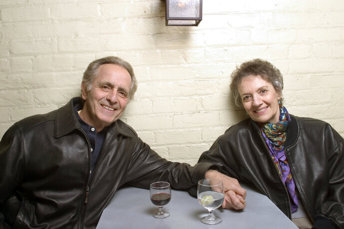 FILE - In this April 8, 2004 file photo, playwright Mark Medoff, left, and actress Phyllis Frelich pose for a photo in New York. Medoff, who wrote the award-winning play