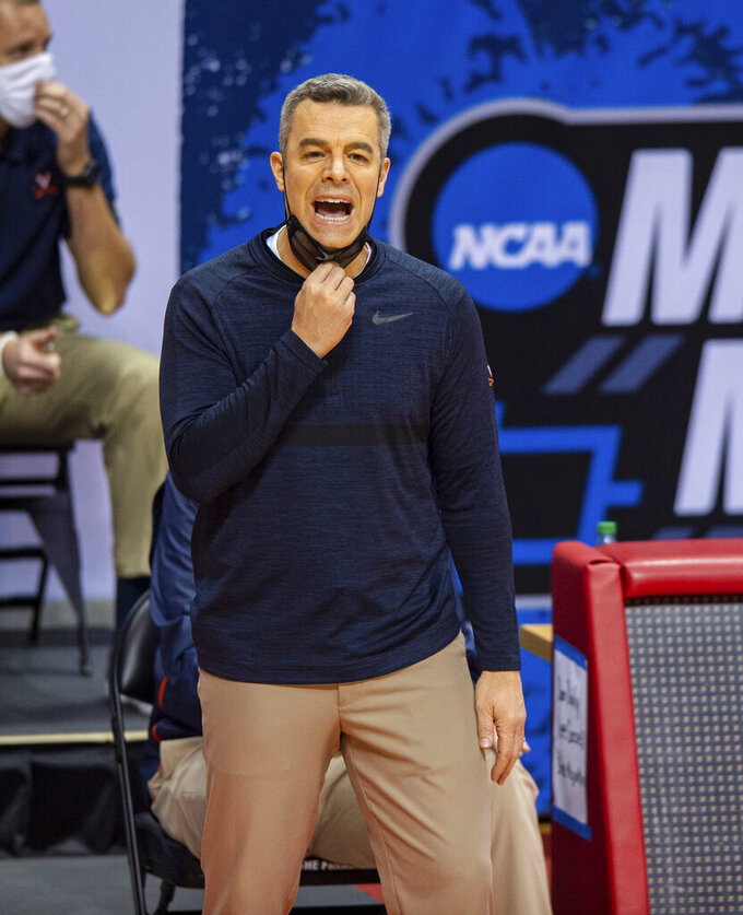 Virginia head coach Tony Bennett reacts to the action on the court during the first half of a first-round game against Ohio in the NCAA men's college basketball tournament, Saturday, March 20, 2021, at Assembly Hall in Bloomington, Ind. (AP Photo/Doug McSchooler)