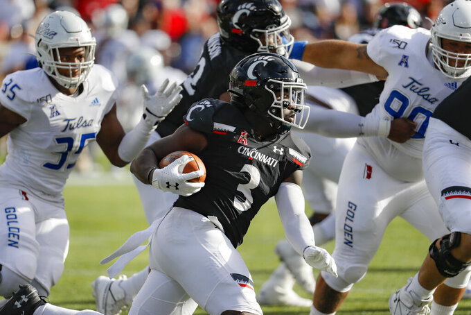 Cincinnati running back Michael Warren II (3) runs the ball during the first half of an NCAA college football game against Tulsa, Saturday, Oct. 19, 2019, in Cincinnati. (AP Photo/John Minchillo)