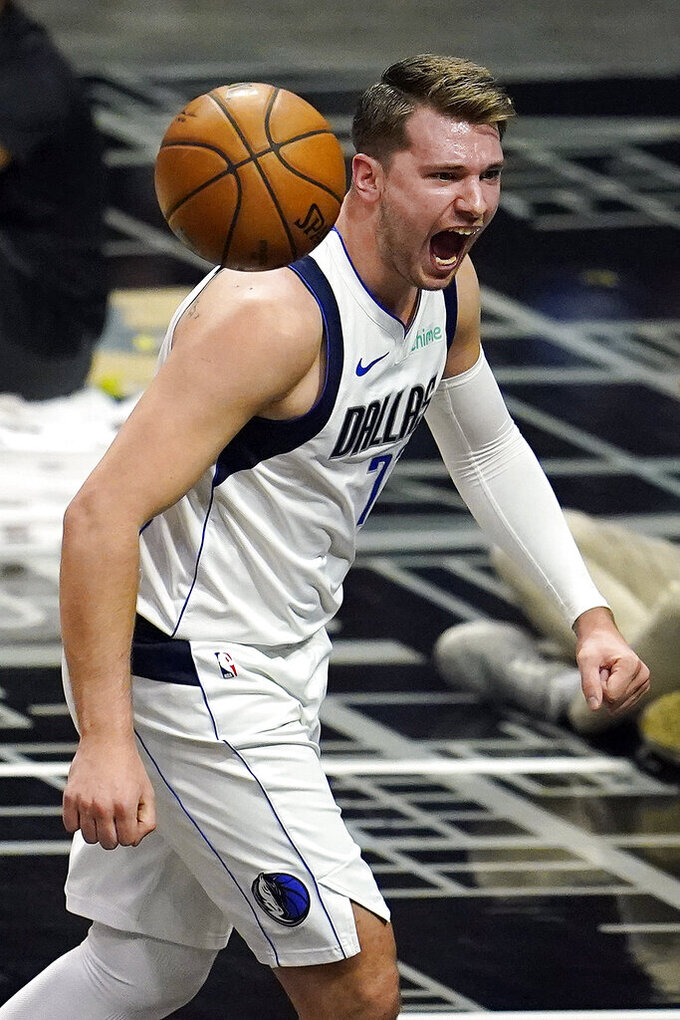Dallas Mavericks guard Luka Doncic celebrates after dunking during the first half in Game 2 of the team's NBA basketball first-round playoff series against the Los Angeles Clippers on Tuesday, May 25, 2021, in Los Angeles. (AP Photo/Marcio Jose Sanchez)