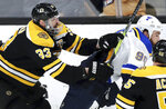 Boston Bruins' Zdeno Chara (33), of Slovakia, checks St. Louis Blues' Ryan O'Reilly (90) during the first period in Game 5 of the NHL hockey Stanley Cup Final, Thursday, June 6, 2019, in Boston. (AP Photo/Charles Krupa)