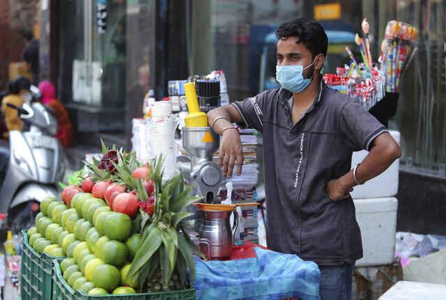A vendor wearing a face mask as a precaution against the coronavirus waits for customers at a market in Jammu, India, Saturday, Sept. 19, 2020. India's coronavirus cases are now the second-highest in the world and only behind the United States. (AP Photo/Channi Anand)