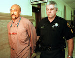 In this Oct. 29, 1998 photo, Robert Wideman, left, is escorted from Judge James McGregor's courtroom in Pittsburgh after he was denied bail pending his new murder trial. Wideman, the brother of prize-winning author John Edgar Wideman has moved one step closer to freedom, after a Pennsylvania parole board recommended pardoning him for a 1975 killing. Wideman was sentenced to life without parole and has been in a state prison since his conviction in a shooting case. He was the subject of his older brother's acclaimed 1984 memoir
