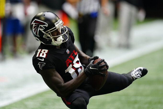 Atlanta Falcons wide receiver Calvin Ridley (18) makes the catch against the Washington Football Team during the second half of an NFL football game, Sunday, Oct. 3, 2021, in Atlanta. (AP Photo/John Bazemore)