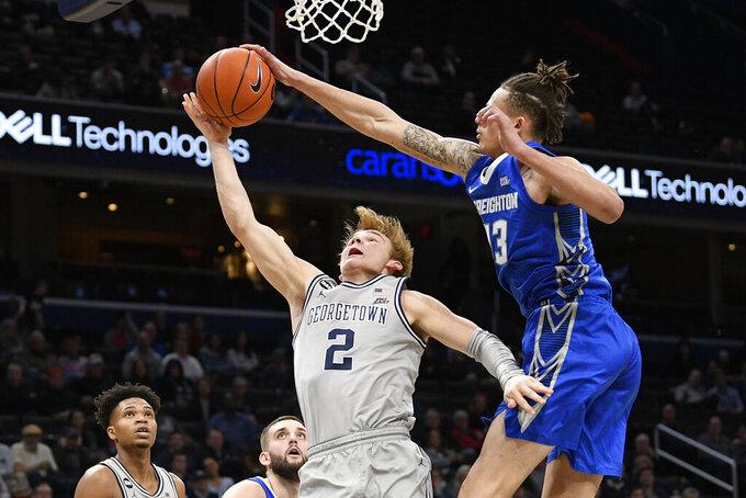 Creighton forward Christian Bishop (13) blocks Georgetown guard Mac McClung (2) during the second half of an NCAA college basketball game, Wednesday, Jan. 15, 2020, in Washington. Georgetown won 83-80. (AP Photo/Nick Wass)
