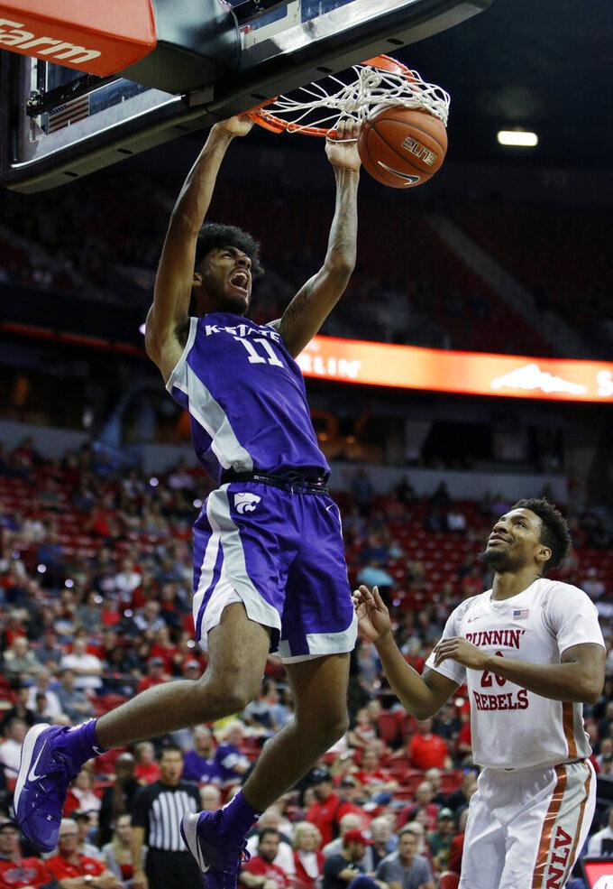Kansas State's Antonio Gordon (11) dunks over UNLV's Nick Blair during the second half of an NCAA college basketball game Saturday, Nov. 9, 2019, in Las Vegas. (AP Photo/John Locher)
