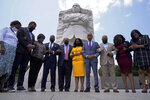 Martin Luther King III, center, with his wife Arndrea Waters King, in yellow, and Rev. Al Sharpton, right of Mrs. King, pray with members of the Texas State Democratic Delegation at the Martin Luther King, Jr. Memorial, Wednesday July 28, 2021, in Washington. From left are, Rep. Sheryl Cole, Rep. Jarvis Johnson, Rep. Rhetta Bowers, Rep. Ron Reynolds, Martin Luther King III, Arndrea Waters King, Rev. Al Sharpton, Rep. Carl Sherman, Rep. Jasmine Crockett, and Rep. Shawn Thierry. (AP Photo/Jacquelyn Martin)