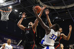 Northeastern guard Max Boursiquot (14) and Hofstra forward Isaac Kante (32) compete for the ball during the second half of an NCAA college basketball game for the championship of the Colonial Athletic Association men's tournament Tuesday, March 10, 2020, in Washington. Hofstra won 70-61. (AP Photo/Nick Wass)