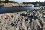 Clothing left behind by Central American migrants who camped out by the Suchiate River cover the riverbank near Ciudad Hidalgo, Mexico, Friday, Jan. 24, 2020. Mexico announced last June that it was deploying the newly formed National Guard to assist in immigration enforcement to avoid tariffs that Trump threatened on Mexican imports. (AP Photo/Marco Ugarte)