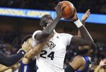 UCF center Tacko Fall (24) drives for a basket against Tulsa during an NCAA basketball game in Orlando, Fla., on Saturday, Jan. 19, 2019. (Stephen M. Dowell/Orlando Sentinel via AP)