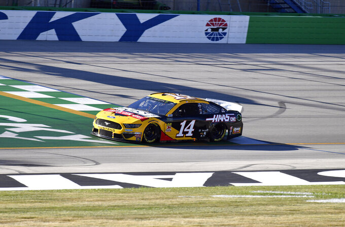 Clint Bowyer crosses the line during qualifying for the NASCAR series auto race at Kentucky Speedway in Sparta, Ky., Friday, July 12, 2019. (AP Photo/Timothy D. Easley)