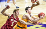 Drexel forward James Butler (51) grabs a rebound next to Elon forward Federico Poser (5) during the first half of an NCAA college basketball game for the Colonial Athletic Association men's tournament championship in Harrisonburg, Va., Tuesday, March 9, 2021. (AP Photo/Daniel Lin)