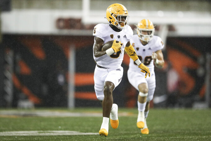 Arizona State running back Rachaad White (3) rushes during the first half of an NCAA college football game against Oregon State in Corvallis, Ore., Saturday, Dec. 19, 2020. (AP Photo/Amanda Loman)