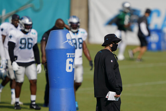 Carolina Panthers head coach Matt Rhule watches during an NFL football camp practice Monday, Aug. 17, 2020, in Charlotte, N.C. (AP Photo/Chris Carlson)