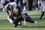New England Patriots tight end Ryan Izzo, below, fumbles as Denver Broncos cornerback Michael Ojemudia (23) tackles him in the second half of an NFL football game, Sunday, Oct. 18, 2020, in Foxborough, Mass. (AP Photo/Charles Krupa)