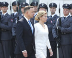 Polish President Andrzej Duda, left, and Slovakian President Zuzana Caputova,right, attend a military welcome ceremony at the presidential Palace in Warsaw, Poland, Monday, July 15, 2019. Caputova is staying for an official visit in Poland. (AP Photo/Czarek Sokolowski)