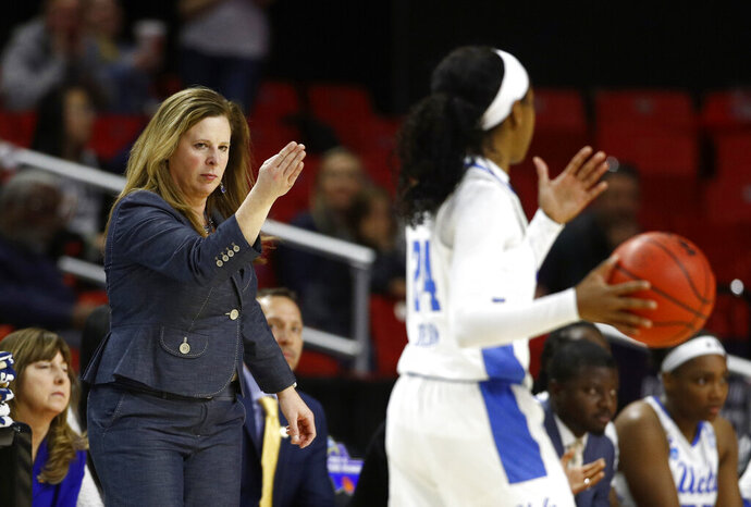 UCLA head coach Cori Close, left, directs guard Japreece Dean in the second half of a first-round game against Tennessee in the NCAA women's college basketball tournament, Saturday, March 23, 2019, in College Park, Md. (AP Photo/Patrick Semansky)
