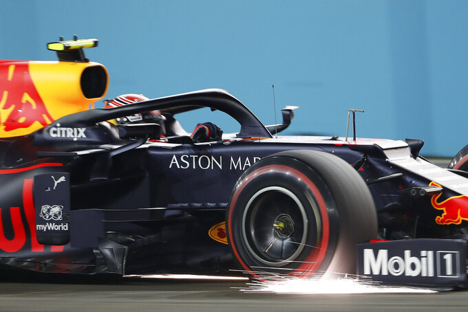 Red Bull driver Alexander Albon of Thailand steers his car during the qualifying round for the Singapore Formula One Grand Prix at the Marina Bay City Circuit in Singapore, Saturday, Sept. 21, 2019. (AP Photo/Vincent Thian)