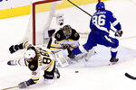 Boston Bruins goaltender Jaroslav Halak (41) makes a save on Tampa Bay Lightning right wing Nikita Kucherov (86) as Bruins right wing David Pastrnak (88) misses the play during the first period in Game 1 of an NHL hockey second-round playoff series, Sunday, Aug. 23, 2020, in Toronto. (Frank Gunn/The Canadian Press via AP)