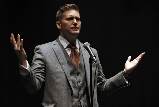 """FILE - In this Oct. 19, 2017, file photo, Richard Spencer, a white supremacist, speaks at the University of Florida in Gainesville, Fla. Spencer has dubbed Bitcoin the """"currency of the alt-right."""" (AP Photo/Chris O'Meara, File)"""