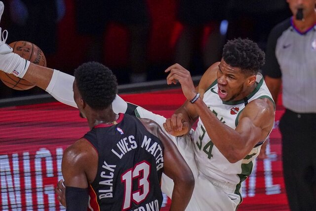 Milwaukee Bucks' Giannis Antetokounmpo dunks over Miami Heat's Bam Adebayo during the first half of an NBA conference semifinal playoff basketball game Sunday, Sept. 6, 2020, in Lake Buena Vista, Fla. (AP Photo/Mark J. Terrill)