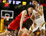 Rutgers guard Geo Baker (0) drives on Minnesota guard Gabe Kalscheur (22) during the second half of an NCAA college basketball game Saturday, Jan. 12, 2019, in Minneapolis. Minnesota defeated Rutgers 88-70. (AP Photo/Andy Clayton-King)