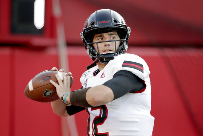 Northern Illinois quarterback Ross Bowers (12) warms up before playing an NCAA college football game against Nebraska in Lincoln, Neb., Saturday, Sept. 14, 2019. (AP Photo/Nati Harnik)