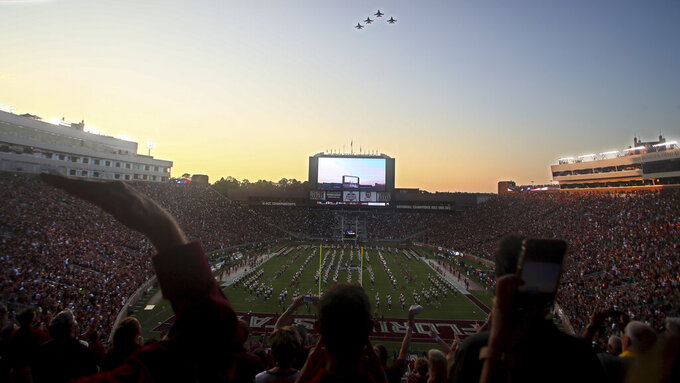 Fighter jets fly over the stadium before the start of an NCAA college football game between Florida State and Notre Dame, Sunday, Sept. 5, 2021, in Tallahassee, Fla. (AP Photo/Phil Sears)