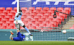 Chelsea's Hakim Ziyech, bottom, scores his side's opening goal during the English FA Cup semifinal soccer match between Chelsea and Manchester City at Wembley Stadium in London, England, Saturday, April 17, 2021. (Ben Stansall, Pool via AP)