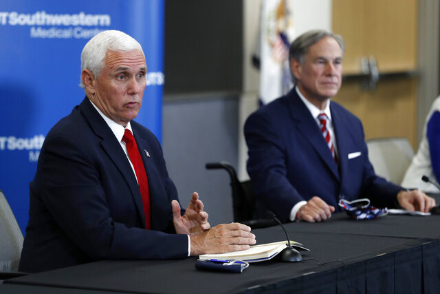 Vice President Mike Pence, left, and Texas Gov. Greg Abbott, right, respond to questions during a news conference after Pence met with Abbott and members of his health care team regarding COVID-19 at the University of Texas Southwestern Medical Center West Campus in Dallas, Sunday, June 28, 2020. (AP Photo/Tony Gutierrez)