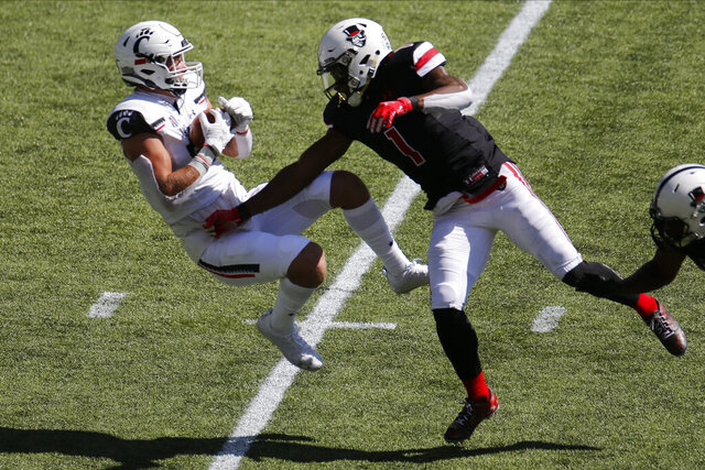 Cincinnati tight end Josh Whyle, left, grabs a pass over Austin Peay defensive back Kam Ruffin during the second half of an NCAA college football game Saturday, Sept. 19, 2020, in Cincinnati, Ohio. Cincinnati beat Austin Peay 55-20. (AP Photo/Jay LaPrete)