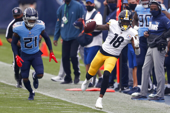 Pittsburgh Steelers wide receiver Diontae Johnson (18) tries to stay in bounds as he gets past Tennessee Titans cornerback Malcolm Butler (21) in the first half of an NFL football game Sunday, Oct. 25, 2020, in Nashville, Tenn. (AP Photo/Wade Payne)