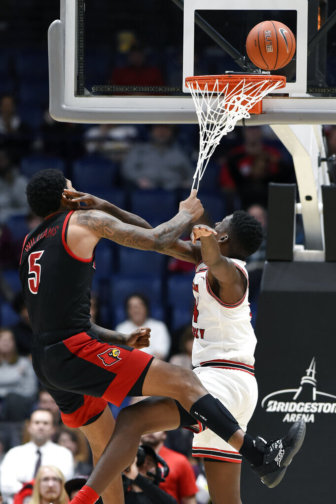 Western Kentucky forward Matt Hortonright, right, is fouled by Louisville forward Malik Williams (5) during the first half of an NCAA college basketball game Friday, Nov. 29, 2019, in Nashville, Tenn. (AP Photo/Mark Zaleski)