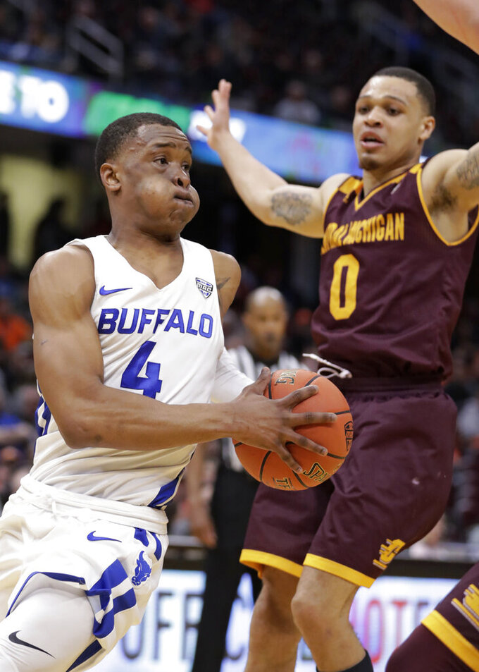Buffalo's Davonta Jordan (4) drives past Central Michigan's Larry Austin Jr. (0) during the second half of an NCAA college basketball game in the semifinals of the Mid-American Conference men's tournament Friday, March 15, 2019, in Cleveland. Buffalo won 85-81. (AP Photo/Tony Dejak)