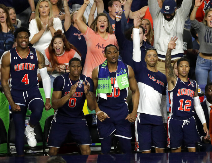 Auburn players react during the second half in the semifinals of the Final Four NCAA college basketball tournament against Virginia, Saturday, April 6, 2019, in Minneapolis. (AP Photo/Matt York)