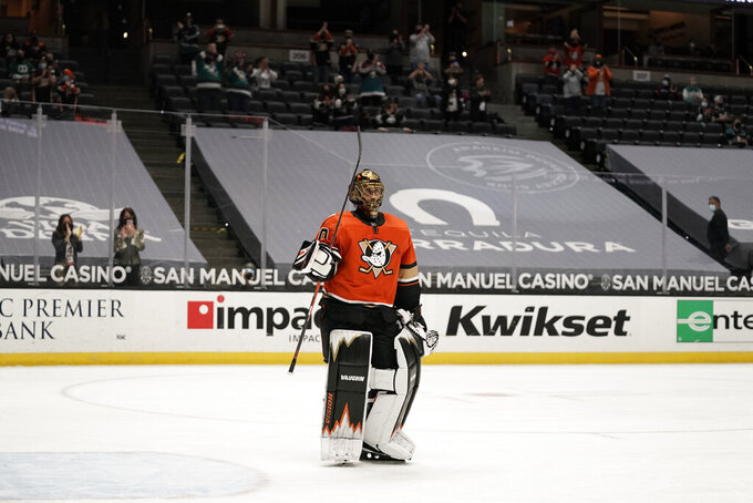 Playing his last home game, Anaheim Ducks goaltender Ryan Miller acknowledges fans during the first period of the team's NHL hockey game against the Los Angeles Kings on Saturday, May 1, 2021, in Anaheim, Calif. Miller will retire at the conclusion of the season. (AP Photo/Jae C. Hong)