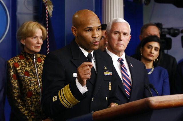 In this March 9, 2020, photo Surgeon General Jerome Adams speaks in the briefing room of the White House in Washington about the coronavirus outbreak. Standing behind Adams are Dr. Deborah Birx, White House coronavirus response coordinator, from left, Vice President Mike Pence and Administrator of the Centers for Medicare and Medicaid Services Seema Verma. (AP Photo/Patrick Semansky, File)