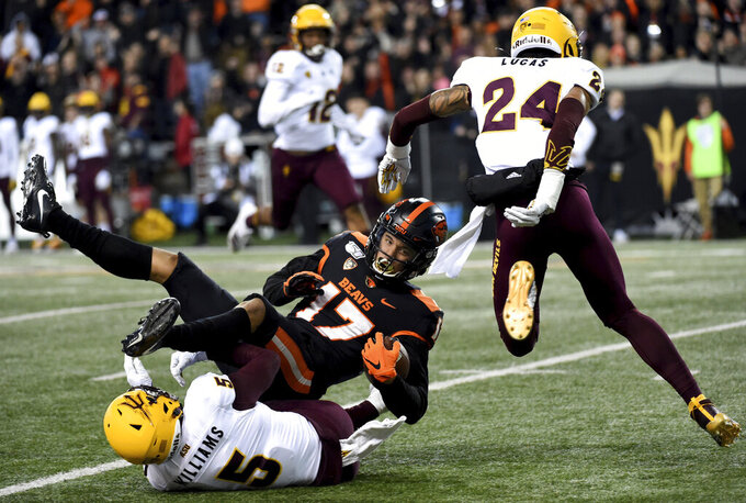 Oregon State wide receiver Isaiah Hodgins (17) is tackled by Arizona State defensive back Kobe Williams during the first half of an NCAA college football game in Corvallis, Ore., Saturday, Nov. 16, 2019. (AP Photo/Steve Dykes)