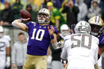 Washington quarterback Jacob Eason (10) passes against Oregon in the first half of an NCAA college football game Saturday, Oct. 19, 2019, in Seattle. (AP Photo/Elaine Thompson)
