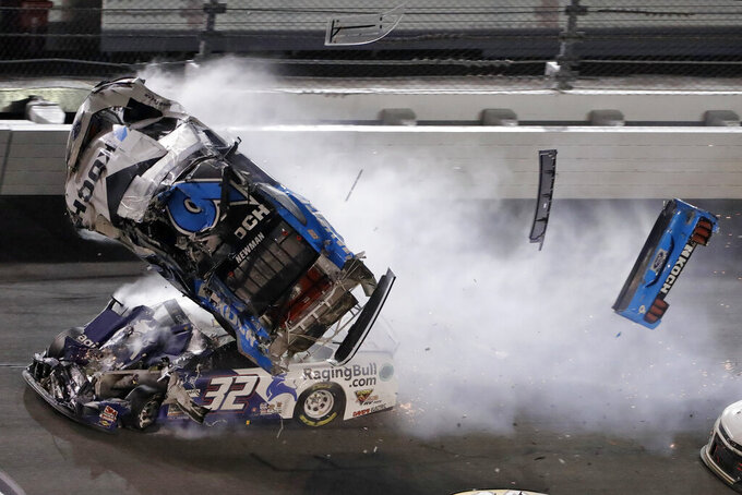 Ryan Newman (6) goes airborne after crashing into Corey LaJoie (32) during the NASCAR Daytona 500 auto race Monday, Feb. 17, 2020, at Daytona International Speedway in Daytona Beach, Fla. Sunday's running of the race was postponed by rain. (AP Photo/Chris O'Meara)