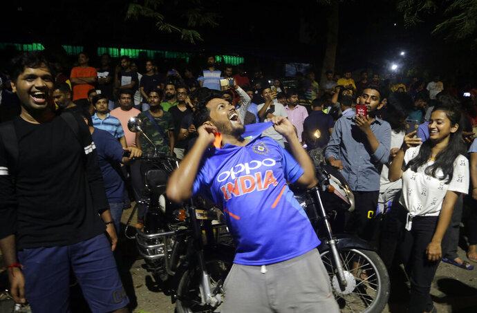 Indians celebrate after their team won the ICC World Cup cricket match against Pakistan, in Mumbai, India, Sunday, June 16, 2019.(AP Photo/Rajanish Kakade)