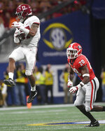 Alabama wide receiver Jaylen Waddle (17) makes a catch against Georgia defensive back J.R. Reed (20) during the second half of the Southeastern Conference championship NCAA college football game, Saturday, Dec. 1, 2018, in Atlanta. (AP Photo/John Amis)